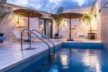 Boutique Hotel Capo Blu la piscina di notte